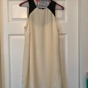 soft cream dress w/ black leather shoulder detail